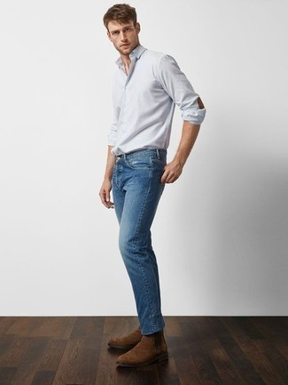 How To Wear Jeans With Boots For Men: This is indisputable proof that a light blue vertical striped long sleeve shirt and jeans look amazing when worn together in a casual outfit. To introduce some extra zing to your getup, complete this look with boots.