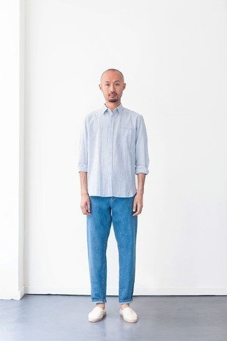 Men's Outfits 2020: If you're scouting for a laid-back and at the same time dapper look, wear a light blue vertical striped long sleeve shirt with blue jeans. Introduce a pair of white canvas espadrilles to the equation and the whole look will come together brilliantly.