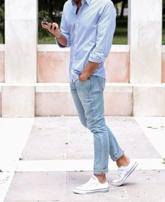How to wear: light blue vertical striped long sleeve shirt, light blue jeans, white canvas low top sneakers