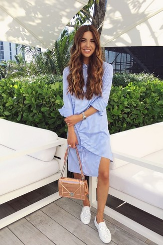 How to wear: light blue vertical striped shirtdress, white embellished slip-on sneakers, gold leather satchel bag