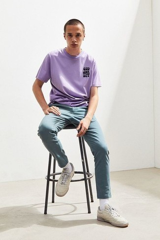 Beige Leather Low Top Sneakers Outfits For Men: A light violet print crew-neck t-shirt and light blue chinos make for a cool casual uniform. A pair of beige leather low top sneakers is a smart pick to complete your outfit.