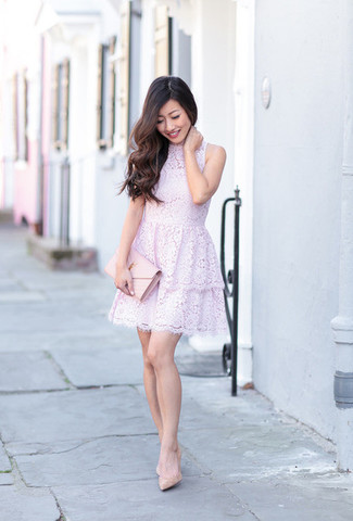 How to Wear a Pink Leather Clutch: This combination of a light violet lace fit and flare dress and a pink leather clutch provides comfort and functionality and helps you keep it clean yet modern. Beige leather pumps will bring an added dose of style to an otherwise too-common look.