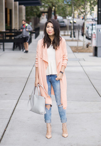 How to wear: pink long cardigan, white peplum top, blue ripped skinny jeans, beige leather pumps