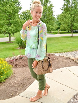 Wear a pastel green floral long sleeve blouse and green casual pants for both chic and easy-to-wear look. For something more on the daring side to complement this ensemble, make thong sandals your footwear choice. What better option for a roasting hot day?