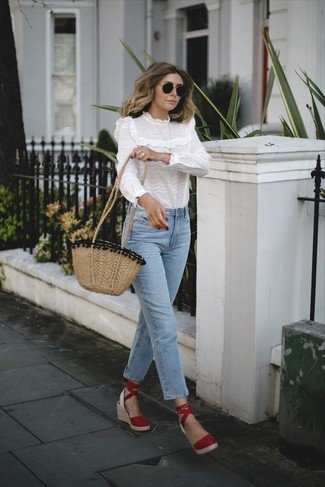 How to wear: white ruffle long sleeve blouse, light blue jeans, red suede wedge sandals, tan straw crossbody bag