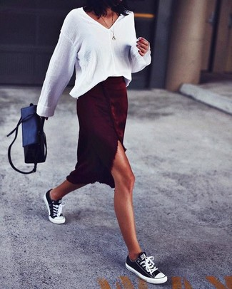 How to Wear a White Linen Long Sleeve Blouse: Why not wear a white linen long sleeve blouse and a burgundy slit midi skirt? As well as very functional, both pieces look great combined together. Round off your look with black and white canvas low top sneakers to serve a little mix-and-match magic.
