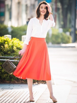 How to Wear Tan Suede Pumps: For relaxed dressing with a modern twist, try pairing a white long sleeve blouse with a red pleated midi skirt. Tan suede pumps tie the look together.
