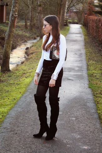Consider wearing a white embellished long sleeve blouse and a black velvet mini skirt and you'll look like a total babe. Round off this look with black suede thigh high boots.