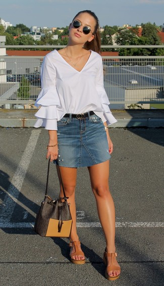 How to wear: white ruffle long sleeve blouse, blue denim mini skirt, tan leather wedge sandals, dark brown leather bucket bag