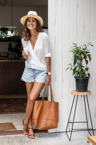 A white long sleeve blouse and light blue shorts will give off this very sexy and chic vibe. A pair of brown leather flat sandals brings the dressed-down touch to the ensemble.