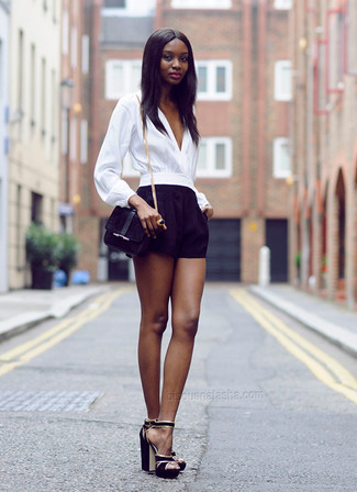 How to wear: white long sleeve blouse, black shorts, black suede heeled sandals, black suede crossbody bag