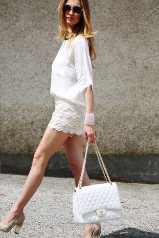 How to wear: white long sleeve blouse, white crochet shorts, beige suede pumps, white quilted leather satchel bag