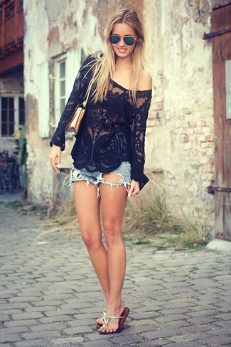 This combination of a black lace long sleeve blouse and blue denim shorts embodies comfort and versatility. Bring playfulness to your look with thong sandals. As you know, the key to getting through the hottest time of year is choosing cool combos like this one.