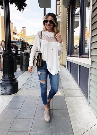 How to wear: white lace long sleeve blouse, navy ripped skinny jeans, grey suede ankle boots, brown leather crossbody bag
