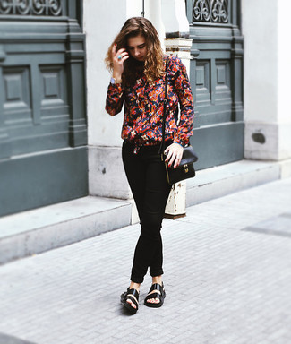 Go for a red and navy floral long sleeve blouse and black skinny jeans for a standout ensemble. Throw in a pair of black leather flat sandals for a more relaxed aesthetic.