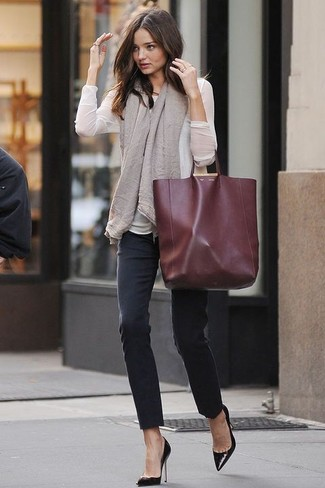 Miranda Kerr wearing White Long Sleeve Blouse, Black Skinny Jeans ...