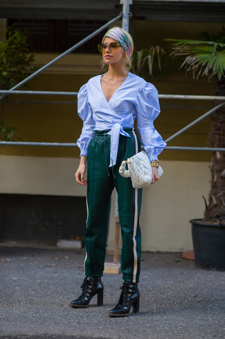 How to wear: light blue long sleeve blouse, dark green leather sweatpants, black leather lace-up ankle boots, white quilted leather tote bag