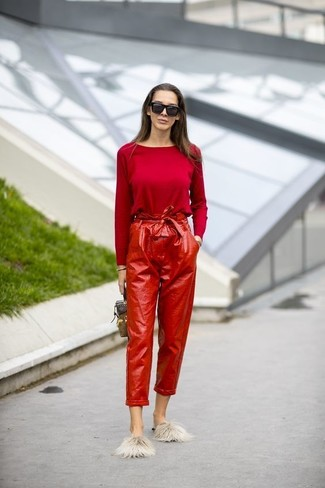 Swing into something classy yet contemporary with a red long sleeve blouse and oxblood leather tapered pants. Why not add flats to the equation for a more relaxed feel? As days are getting cooler, you'll find that an outfit like this is ideal for fall.