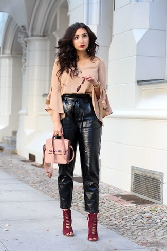 How to wear: beige ruffle long sleeve blouse, black leather tapered pants, burgundy suede heeled sandals, pink leather crossbody bag