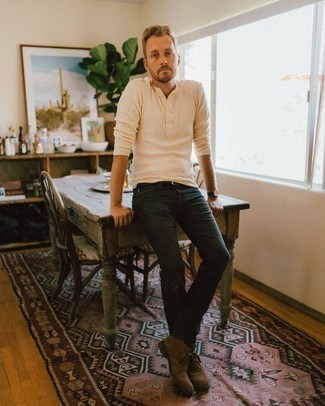 Beige Long Sleeve Henley Shirt Outfits For Men: A beige long sleeve henley shirt and navy jeans are essential in any modern man's versatile casual closet. And if you need to easily bump up your getup with shoes, complete this ensemble with brown suede desert boots.