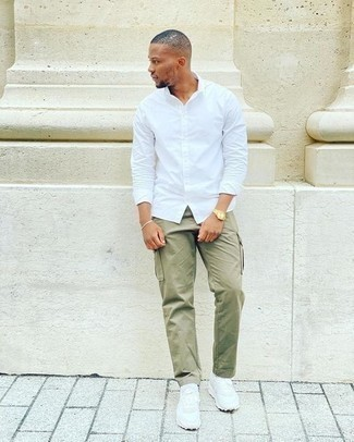 Gold Watch Outfits For Men: Try teaming a white long sleeve shirt with a gold watch to assemble an urban and stylish ensemble. White athletic shoes are a never-failing footwear option here that's also full of personality.