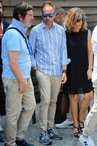 How to Wear a Light Blue Vertical Striped Long Sleeve Shirt For Men: Wear a light blue vertical striped long sleeve shirt with beige chinos for a daily look that's full of charm and personality. A pair of navy athletic shoes effortlessly turns up the wow factor of your ensemble.
