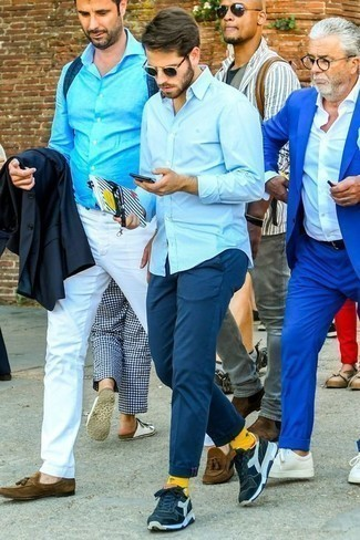 How to Wear Navy Sunglasses For Men: Opt for a light blue long sleeve shirt and navy sunglasses to create a laid-back and absolutely dapper getup. Add navy and white athletic shoes to the mix et voila, the ensemble is complete.