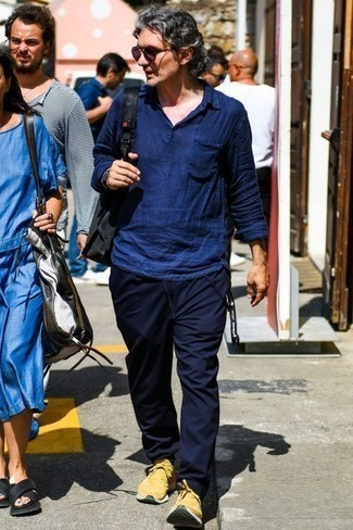 How to Wear Yellow Athletic Shoes For Men: Swing into something casual yet contemporary with a navy linen long sleeve shirt and navy chinos. And if you want to effortlessly tone down this outfit with a pair of shoes, add yellow athletic shoes to the equation.
