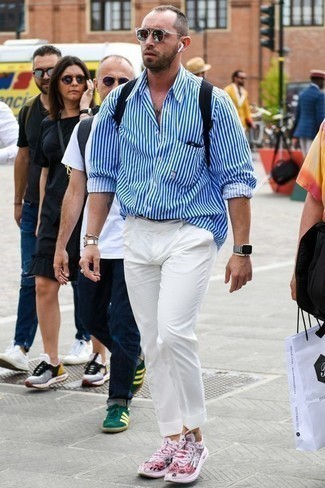 How to Wear a Grey Watch For Men: This off-duty combination of a white and blue vertical striped long sleeve shirt and a grey watch is very easy to pull together without a second thought, helping you look seriously stylish and ready for anything without spending too much time digging through your wardrobe. Serve a little outfit-mixing magic by rocking a pair of pink athletic shoes.