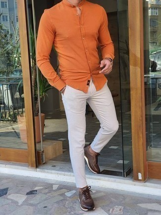 Dark Brown Athletic Shoes Outfits For Men: An orange long sleeve shirt and white chinos work together harmoniously. A pair of dark brown athletic shoes effortlessly kicks up the street cred of this look.