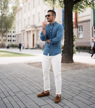 How to wear: blue chambray long sleeve shirt, white chinos, brown suede boat shoes, black sunglasses