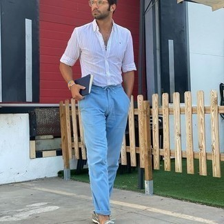 White Vertical Striped Long Sleeve Shirt Outfits For Men: To put together a relaxed look with a twist, you can go for a white vertical striped long sleeve shirt and light blue chinos. Complete your ensemble with grey leather boat shoes and the whole outfit will come together.