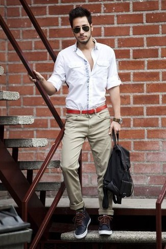 How to wear: white long sleeve shirt, khaki chinos, navy leather casual boots, black canvas backpack