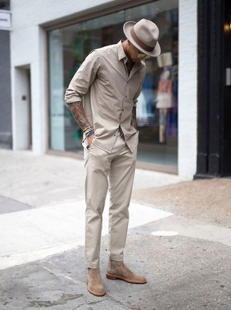 How to wear: beige long sleeve shirt, beige chinos, beige suede chelsea boots, beige wool hat