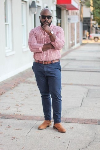 How to Wear Tan Leather Chelsea Boots For Men: If you're looking for an off-duty and at the same time stylish outfit, consider wearing a red and white gingham long sleeve shirt and navy chinos. For something more on the elegant side to complement this getup, add a pair of tan leather chelsea boots to the equation.