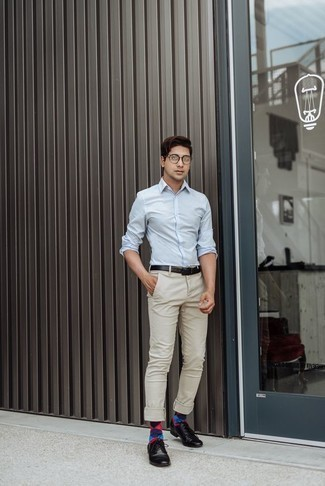 How to Wear Beige Chinos: This getup with a light blue long sleeve shirt and beige chinos isn't a hard one to create and leaves room to more experimentation. Finishing with black leather derby shoes is the most effective way to give a sense of polish to this outfit.