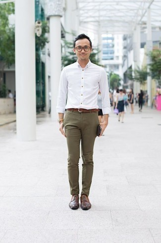 How to Wear a White Long Sleeve Shirt For Men: Pair a white long sleeve shirt with olive chinos for a relaxed casual and fashionable outfit. Complete your outfit with brown leather derby shoes for a touch of elegance.
