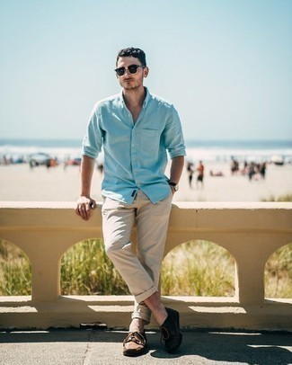 Men's Outfits 2020: If it's ease and practicality that you appreciate in an outfit, consider pairing a light blue long sleeve shirt with beige chinos.