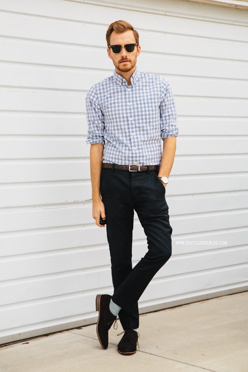 This combo of a light blue gingham long sleeve shirt and black chinos will  enable you