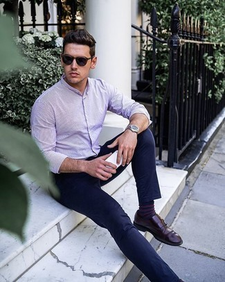 Dress Shoes Outfits For Men: This dapper outfit is really pared down: a white and violet vertical striped long sleeve shirt and navy chinos. You can get a little creative in the footwear department and smarten up this ensemble by slipping into a pair of dress shoes.