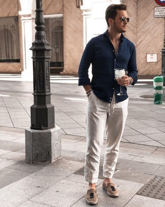Navy Long Sleeve Shirt Outfits For Men: Such must-haves as a navy long sleeve shirt and beige linen chinos are an easy way to introduce effortless cool into your daily arsenal. A pair of tan canvas espadrilles is a savvy choice to finish your outfit.