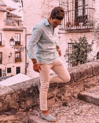 White and Navy Horizontal Striped Canvas Espadrilles Outfits For Men: If you enjoy a more casual approach to styling, why not reach for a mint long sleeve shirt and beige chinos? A pair of white and navy horizontal striped canvas espadrilles will be the perfect accompaniment for this ensemble.