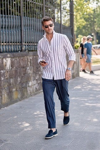 How to Wear Navy Chinos After 40: This is definitive proof that a light violet vertical striped long sleeve shirt and navy chinos are amazing when worn together in a casual getup. Complete your look with a pair of navy suede loafers to instantly turn up the fashion factor of any outfit.