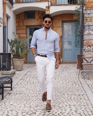 1200+ Hot Weather Outfits For Men: A light blue linen long sleeve shirt and white chinos are the kind of a never-failing casual ensemble that you need when you have no time. To give your overall outfit a sleeker vibe, introduce a pair of brown suede loafers to your ensemble.