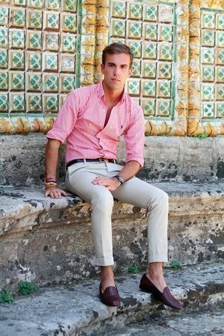 Bracelet Outfits For Men: No matter where the day takes you, you'll be stylishly prepared in this relaxed combination of a white and red vertical striped long sleeve shirt and a bracelet. For something more on the elegant end to complement your ensemble, complete this ensemble with burgundy leather loafers.