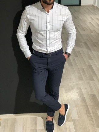 Navy Leather Watch Outfits For Men: Fashionable and practical, this combination of a white vertical striped long sleeve shirt and a navy leather watch will provide you with endless styling opportunities. To give your overall outfit a classier twist, why not introduce a pair of navy canvas loafers to your outfit?