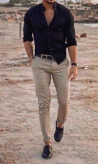 Black Leather Loafers Outfits For Men: Team a navy long sleeve shirt with beige chinos for a practical look that's also put together. Why not complement your ensemble with a pair of black leather loafers for an added touch of style?