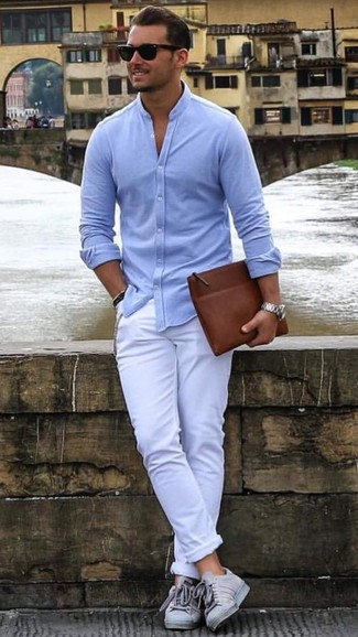 If you don't like putting too much effort into your looks, pair a Brooks Brothers men's Button Down Oxford Shirt with white chinos. Feeling brave? Complete your look with grey low top sneakers. This ensemble is essentially a lesson in how to dress for hot summer weather.