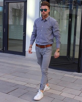 How to wear: grey chambray long sleeve shirt, grey chinos, white leather low top sneakers, tobacco leather belt