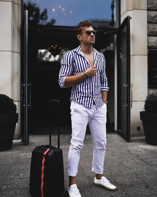 How to wear: white and navy vertical striped long sleeve shirt, white chinos, white leather low top sneakers, black sunglasses